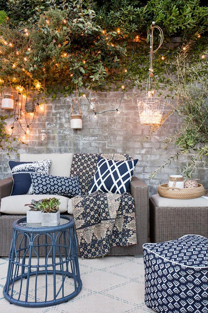 """<p>String lights don't always have to steal the show. Draping them across some plants or a wall adds a lovely but subtle background touch to your outdoor gathering. Piling them into see-through bucket also makes for a pretty lantern.</p><p><strong>See more at <a href=""""https://stylebyemilyhenderson.com/blog/video/take-it-outside-target-patio-makeover"""" rel=""""nofollow noopener"""" target=""""_blank"""" data-ylk=""""slk:Style By Emily Henderson"""" class=""""link rapid-noclick-resp"""">Style By Emily Henderson</a>.</strong></p><p><strong><a class=""""link rapid-noclick-resp"""" href=""""https://www.amazon.com/Prextex-100-Count-Clear-Christmas-Decorations/dp/B075LQ4WTF/ref=sr_1_6?tag=syn-yahoo-20&ascsubtag=%5Bartid%7C10050.g.3404%5Bsrc%7Cyahoo-us"""" rel=""""nofollow noopener"""" target=""""_blank"""" data-ylk=""""slk:Shop Christmas Lights"""">Shop Christmas Lights</a><br></strong></p>"""