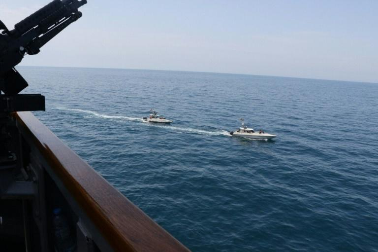 A US Navy file photo taken on April 15 shows Iranian Islamic Revolutionary Guard Corps Navy vessels near the guided-missile destroyer USS Paul Hamilton in the Gulf (AFP Photo/Handout)