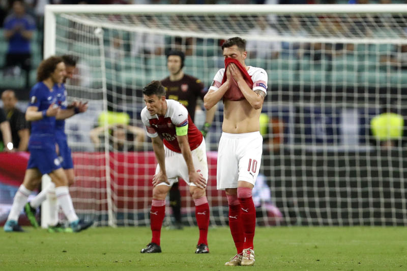 Arsenal's Mesut Ozil reacts after Chelsea's Eden Hazard scored their side's fourth goal during the Europa League Final soccer match between Chelsea and Arsenal at the Olympic stadium in Baku, Azerbaijan, Thursday, May 30, 2019. (AP Photo/Darko Bandic)