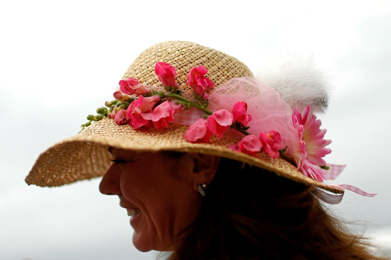 BALTIMORE, MD - MAY 18:  A fan attends the 138th running of the Preakness Stakes at Pimlico Race Course on May 18, 2013 in Baltimore, Maryland.  (Photo by Molly Riley/Getty Images)