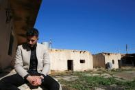 Thikran Kamiran Yousif, 22, is seen during an interview with Reuters at his grandfather's house which was destroyed in past Islamic State militant attacks, in Kojo