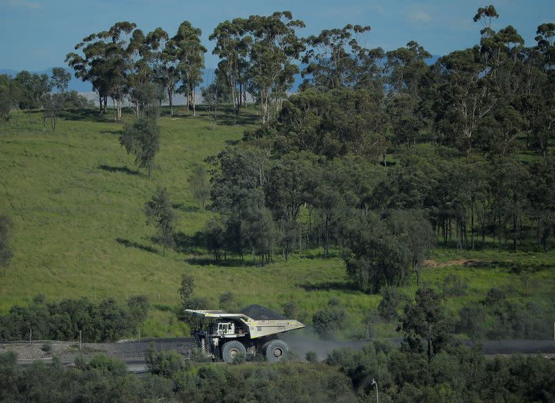 FILE PHOTO: A loaded coal truck drives inside Rio Tinto's Hunter Valley operations in Lemington, north of Sydney, Australia