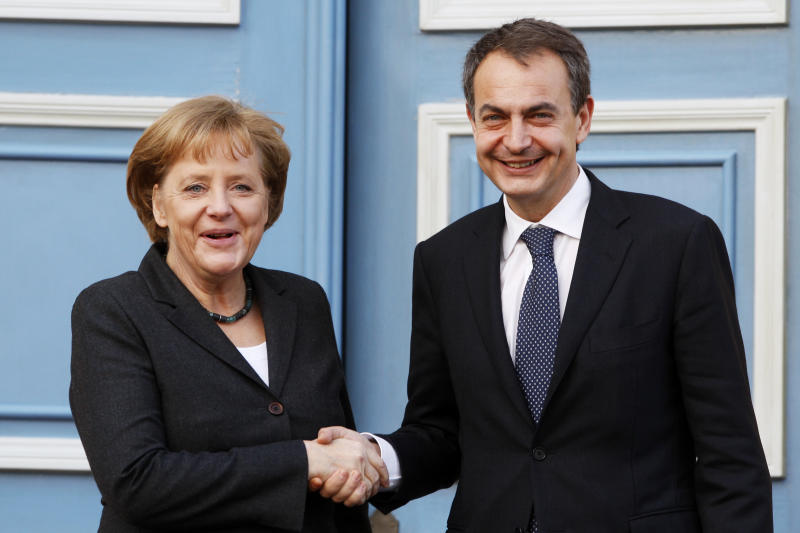 FILE - This is a Monday, March 1, 2010 file photo of Germany's chancellor Angela Merkel as she shakes hands with Spain's prime minister Jose Luis Rodriguez Zapatero prior to the German-Spanish Consultations in Hanover, northern Germany. Often these days, the first order of business at European Union summits is not the continent's dreadful financial crisis. It's getting to know the people around the table. The group of national leaders that will meet this week in Brussels is a different crew from the one that met in October 2009, when the crisis in Europe first erupted with the news that Greece was in deep difficulty. (AP Photo/Heribert Proepper, File)