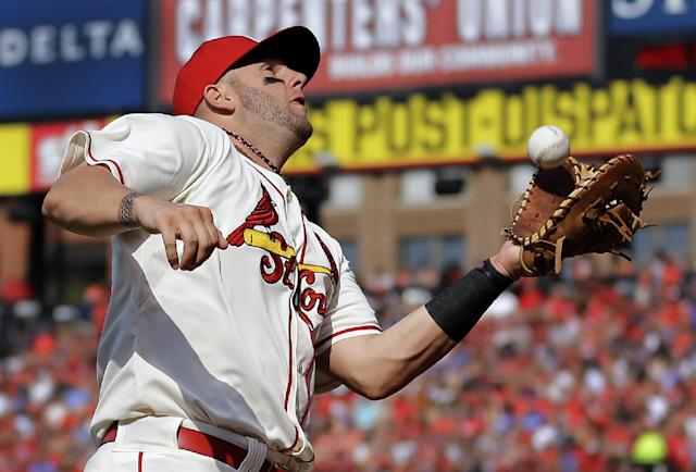 St. Louis Cardinals first baseman Matt Adams catches a ball hit by Los Angeles Dodgers' Yasiel Puig in foul territory for an out during the sixth inning of a baseball game Saturday, July 19, 2014, in St. Louis. (AP Photo/Jeff Roberson)