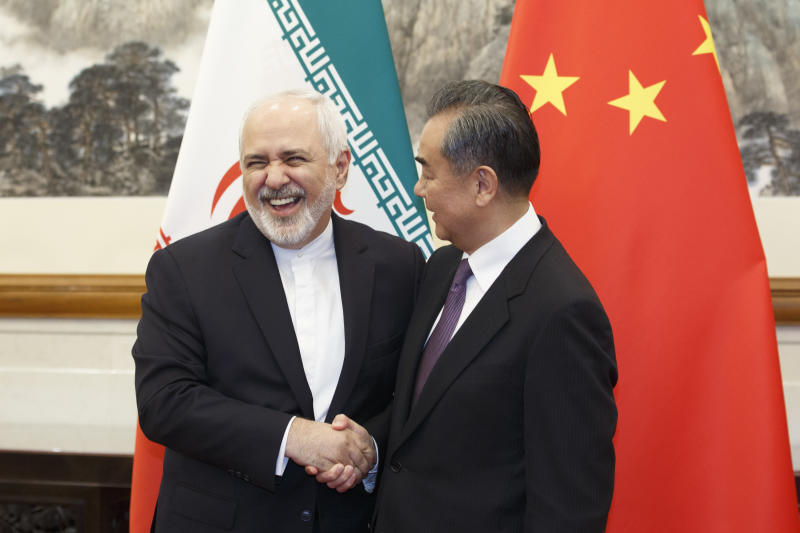 Chinese Foreign Minister Wang Yi meets Iranian Foreign Minister Mohammad Javad Zarif at the Diaoyutai State Guesthouse in Beijing, Friday, May 17, 2019. (Thomas Peter/Pool Photo via AP)