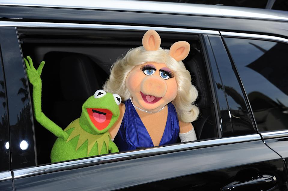 "Muppets Kermit the Frog and Miss Piggy arrive at the premiere of Disney's 'Muppets Most Wanted"" held at the El Capitan Theatre in Hollywood. (Photo by Frank Trapper/Corbis via Getty Images)"