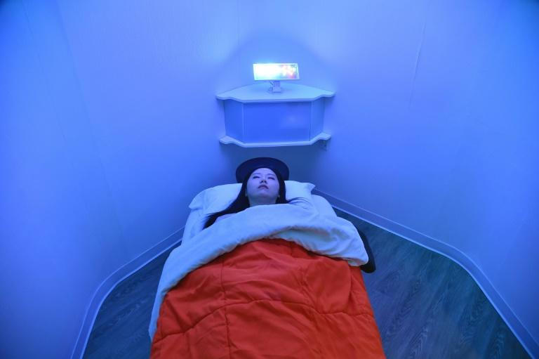 Laura Li prepares to take a nap in YeloSpa, where New Yorkers can recharge their batteries during office hours without having to return home