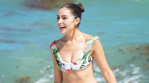 Olivia Culpo Lounges On The Beach In A Bikini & BF Christian McCaffrey Raves Over How 'Fire' She Looks