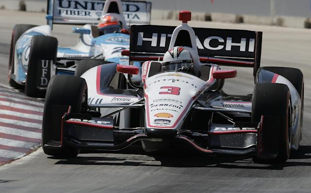Helio Castroneves runs through turn one during the second race of the IndyCar Detroit Grand Prix auto racing doubleheader in Detroit Sunday, June 1, 2014. (AP Photo/Paul Sancya)