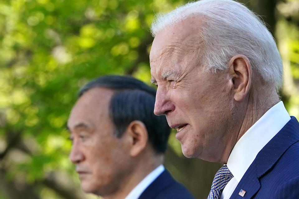 US President Joe Biden and Japan's Prime Minister Yoshihide Suga take part in a joint press conference in the Rose Garden of the White House in Washington, DC on April 16, 2021. (Photo by MANDEL NGAN / AFP) (Photo by MANDEL NGAN/AFP via Getty Images)