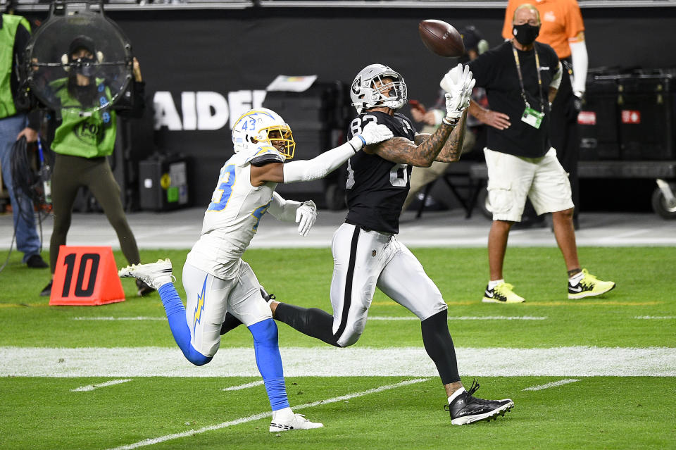 LAS VEGAS, NEVADA - DECEMBER 17: Darren Waller #83 of the Las Vegas Raiders catches a 35 yard pass to score a touchdown against Michael Davis #43 of the Los Angeles Chargers during the second quarter in the game at Allegiant Stadium on December 17, 2020 in Las Vegas, Nevada. (Photo by Chris Unger/Getty Images)