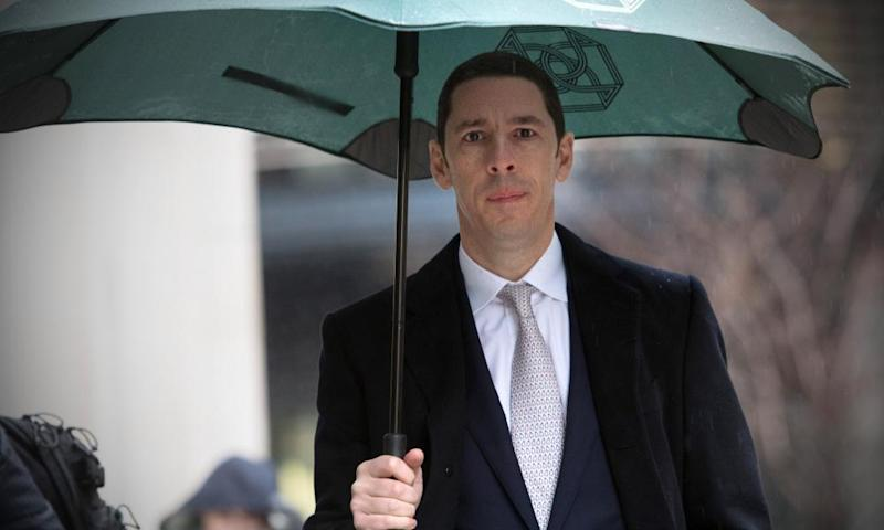 Christian Candy pictured outside the high court with an umbrella