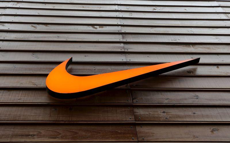 The logo of Nike is seen in a storefront in Sao Paulo