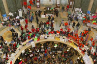 FILE - In this Tuesday, Feb. 22, 2011 file photo, pro-labor protesters bang drums and chant inside the state Capitol in Madison, Wis., during their eighth day of protesting. On Friday, Feb. 5, 2021, The Associated Press reported on a photo circulating online incorrectly asserting it shows Democratic protesters storming the U.S. Capitol during the confirmation of then-Supreme Court nominee Brett Kavanaugh in 2018. That photo is being misrepresented. It was taken in February 2011 at the state Capitol in Madison, during labor demonstrations against to protest a proposal that would effectively strip union workers of collective bargaining rights. (AP Photo/Jeffrey Phelps)