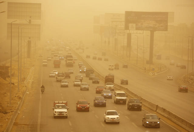 Vehicles drive during a sandstorm in Cairo, Egypt, Wednesday, Jan. 16, 2019 as a thick sandstorm cloaked parts of the Middle East. Sandstorms and harsh weather are blowing through parts of the Middle East, with visibility down in the Egyptian capital as an orange cloud of dust blocked out the sky and pedestrians used fabrics to cover their faces from the gusts. (AP Photo/Amr Nabil)