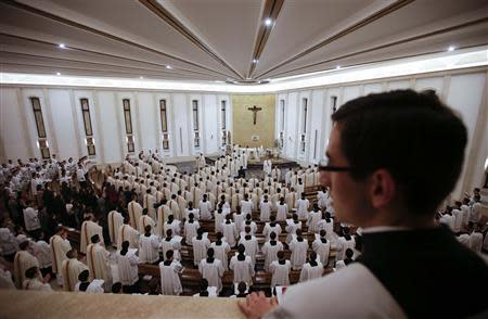 Priests enter in procession for a mass led by Father Eduardo Robles Gil, the new leader of the Legionaries of Christ order, in the order seminary in Rome February 6, 2014. REUTERS/Max Rossi