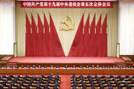 """In this photo released by Xinhua News Agency, Chinese President Xi Jinping, center, also general secretary of the Communist Party of China (CPC) Central Committee, leads other Chinese leaders attending the fifth plenary session of the 19th Central Committee of the Communist Party of China (CPC) in Beijing, China on Oct. 29, 2020. China's leaders are vowing to make their country a self-reliant """"technology power"""" after a meeting to draft a development blueprint for the state-dominated economy over the next five years. (Liu Bin/Xinhua via AP)"""