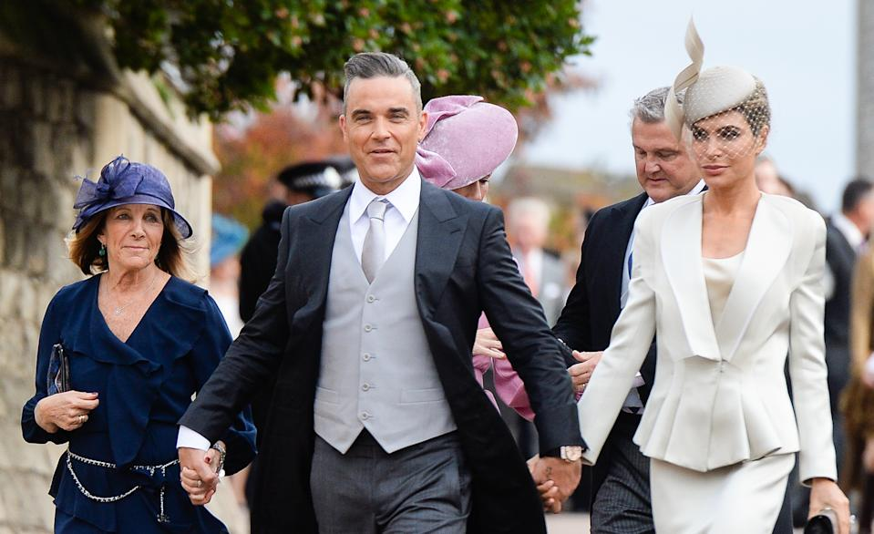 Gwen Field, Robbie Williams and Ayda Field attend the wedding of Princess Eugenie of York and Jack Brooksbank at St George's Chapel in Windsor Castle. (Photo by Pool/Samir Hussein/WireImage)