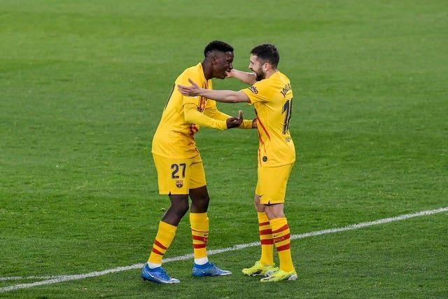 Barcelona's Ilaix Moriba (left) celebrates with his team-mate Lionel Messi after scoring