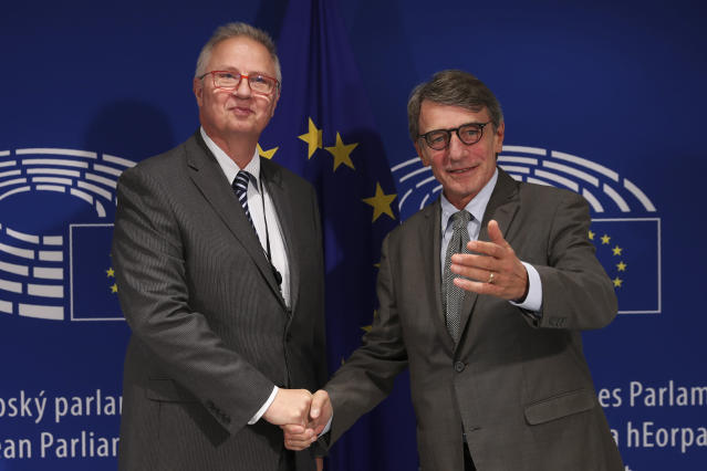 European Commissioner nominated for Neighbourhood and Enlargement Laszlo Trocsanyi, left, is welcomed by European Parliament President David Sassoli before their meeting at the European Parliament in Brussels, Tuesday, Sept. 24, 2019. (AP Photo/Francisco Seco)