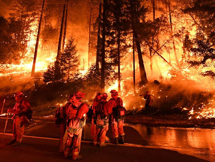 Firefighters try to control a back burn as the Carr Fire continues to spread toward the towns of Douglas City and Lewiston near Redding, Calif., on July 31. (Photo: Mark Ralston/AFP/Getty Images)
