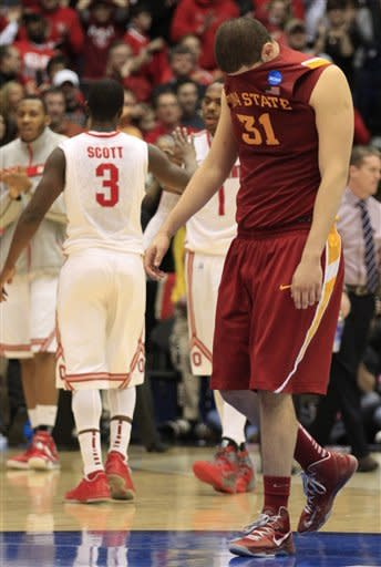 Iowa State forward Georges Niang (31) walks off the court after losing to Ohio State 78-75 in a third-round game of the NCAA college basketball tournament on Sunday, March 24, 2013, in Dayton, Ohio. (AP Photo/Skip Peterson)