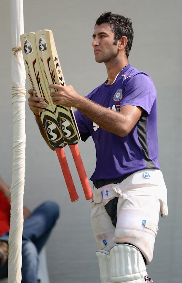 AHMEDABAD, INDIA - NOVEMBER 14:  Cheteshwar Pujara of India looks at his bats during a nets session at Sardar Patel Stadium on November 14, 2012 in Ahmedabad, India.  (Photo by Gareth Copley/Getty Images)