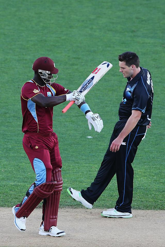 AUCKLAND, NEW ZEALAND - DECEMBER 26:  Darren Sammy of the West Indies celebrates scoring six runs off the bowling of Mitchell McClenaghan of New Zealand during the first One Day International match between New Zealand and the West Indies at Eden Park on December 26, 2013 in Auckland, New Zealand.  (Photo by Hannah Johnston/Getty Images)
