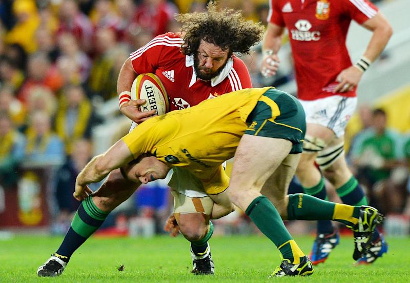 Wallabies centre Pat McCabe (bottom) tackles British and Irish Lions player Adam Jones during the first Test match in Brisbane on June 22, 2013