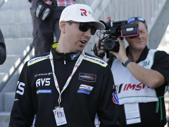 Reigning NASCAR Champion Kyle Busch reacts to a fan before the Rolex 24 hour auto race at Daytona International Speedway, Saturday, Jan. 25, 2020, in Daytona Beach, Fla. Busch will drive a Lexus RC-F GT3 in the race. (AP Photo/Terry Renna)