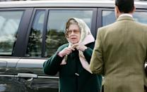 """<p>The Queen is rarely seen in public or on a casual outing without a headscarf — they are <a href=""""https://www.standard.co.uk/fashion/queen-elizabeth-ii-headscarves-fashion-a4380806.html"""" rel=""""nofollow noopener"""" target=""""_blank"""" data-ylk=""""slk:an essential item in her wardrobe"""" class=""""link rapid-noclick-resp"""">an essential item in her wardrobe</a>. And she needs no help fastening them, as demonstrated here at the Royal Windsor Horse Show in 2005.</p>"""