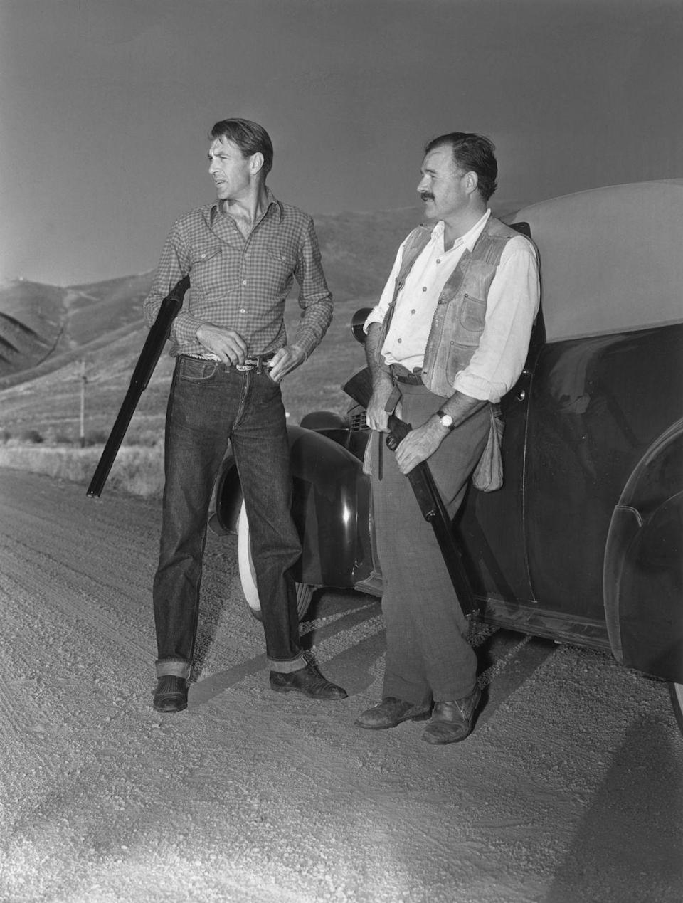 """<p>Gary Cooper and Hemingway were one of Hollywood's greatest bromances back in the day. After <a href=""""https://www.nytimes.com/2013/10/11/movies/cooper-hemingway-an-alliance-of-actor-and-writer.html"""" rel=""""nofollow noopener"""" target=""""_blank"""" data-ylk=""""slk:meeting on the set"""" class=""""link rapid-noclick-resp"""">meeting on the set</a> of the film adaptation of Hemingway's <em><a href=""""https://www.amazon.com/Farewell-Arms-Ernest-Hemingway/dp/0684801469?tag=syn-yahoo-20&ascsubtag=%5Bartid%7C10067.g.36892485%5Bsrc%7Cyahoo-us"""" rel=""""nofollow noopener"""" target=""""_blank"""" data-ylk=""""slk:A Farewell to Arms"""" class=""""link rapid-noclick-resp"""">A Farewell to Arms</a> </em>in 1932, which Cooper starred in, they became good friends. Here, they take a break from pheasant shooting at Cooper's ranch in Sun Valley, Idaho. </p>"""