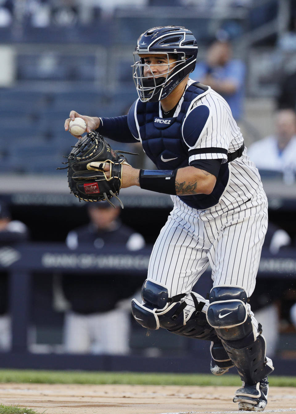 NEW YORK, NY - MAY 7:  Catcher Gary Sanchez #24 of the New York Yankees runs the ball towards third base during a rundown as Domingo Santana was caught between 3rd base and home before being tagged out in the second inning of an MLB baseball game against the Seattle Mariners on May 7, 2019 at Yankee Stadium in the Bronx borough of New York City. Yankees won 5-4. (Photo by Paul Bereswill/Getty Images)