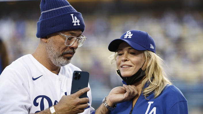"""Comedian Jo Koy (L) and comedian/actress Chelsea Handler (R) take a selfie at a Los Angeles Dodgers game. <span class=""""copyright"""">Michael Owens/Getty Images</span>"""
