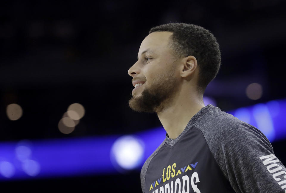 Golden State Warriors guard Stephen Curry is reportedly part of a group hoping to purchase the Carolina Panthers. (AP Photo/Jeff Chiu)