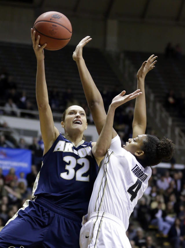 Akron forward Rachel Tecca (32) shoots over Purdue forward Torrie Thornton during the first half of a first-round game in the NCAA women's college basketball tournament, Saturday, March 22, 2014, in West Lafayette, Ind. (AP Photo/Michael Conroy)
