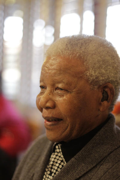 Former South African President Nelson Mandela as he celebrates his birthday in Qunu, South Africa, Wednesday, July 18, 2012. Across the country, and even abroad, people are doing good deeds to honor the country's most famous statesman on his 94th birthday Wednesday. (AP Photo/Schalk van Zuydam)