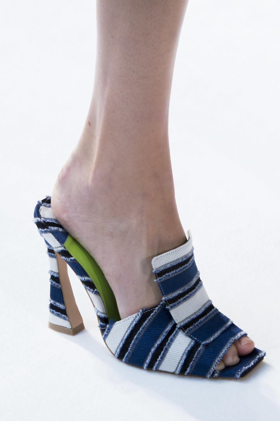 <p><i>Blue and white striped mules from the SS18 Christan Siriano collection. (Photo: ImaxTree) </i></p>