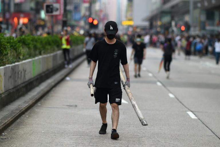 Rallies erupted in multiple Hong Kong neighbourhoods with some protesters blocking roads, throwing objects onto train tracks as well as spraying graffiti and smashing the windows of some pro-China businesses