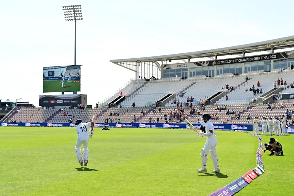 India's Virat Kohli (L) and India's Cheteshwar Pujara walk out on to the pitch to bat on the final day of the ICC World Test Championship Final between New Zealand and India at the Ageas Bowl in Southampton, southwest England on June 23, 2021. - RESTRICTED TO EDITORIAL USE (Photo by Glyn KIRK / AFP) / RESTRICTED TO EDITORIAL USE (Photo by GLYN KIRK/AFP via Getty Images)