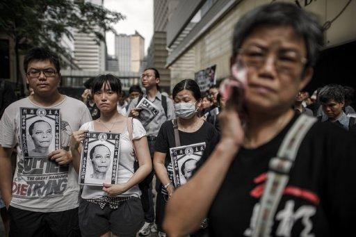 People take part in a protest for the cause of late Chinese dissident Li Wangyang in Hong Kong on June 10. Hong Kong's incoming leader Leung Chun-ying observed a minute's silence Saturday in memory of Li in the latest display of concern in the southern Chinese city over his death