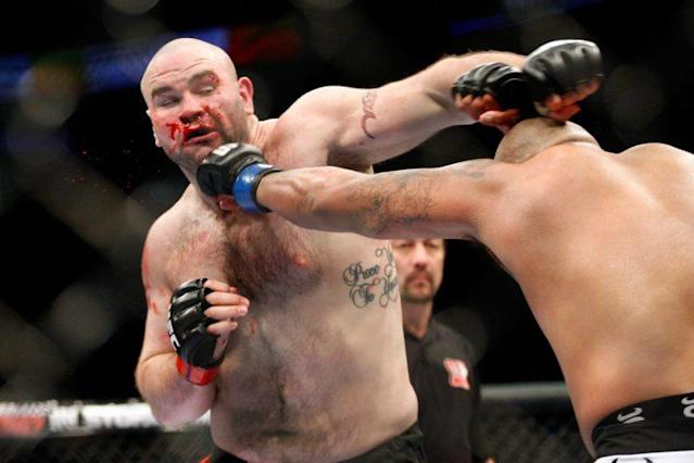 Tim Hague (L), shown during a 2010 UFC fight with Joey Beltran, died Sunday in Edmonton as a result of injuries he suffered in a boxing match. (Getty Images)