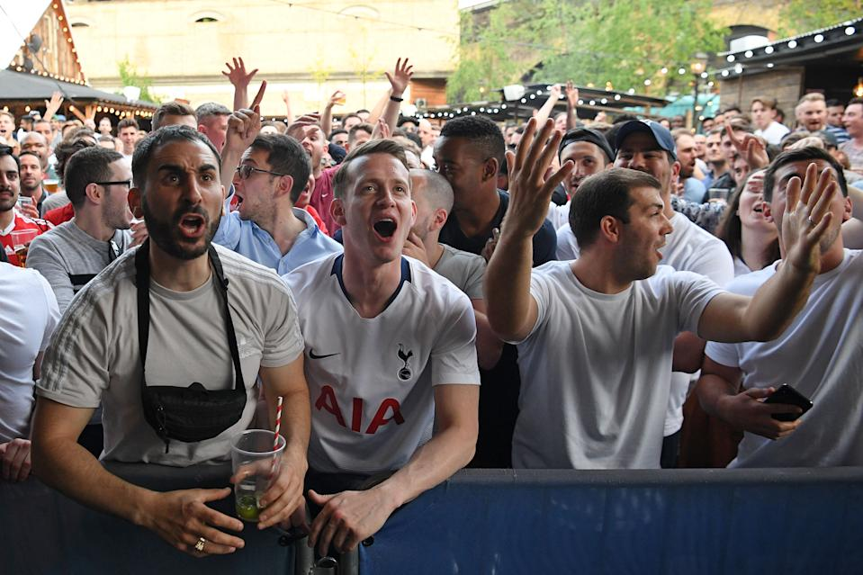Tottenham supporters in Flat Iron Square in London react to Liverpool being given an early penalty kick (Photo by Daniel LEAL-OLIVAS / AFP)