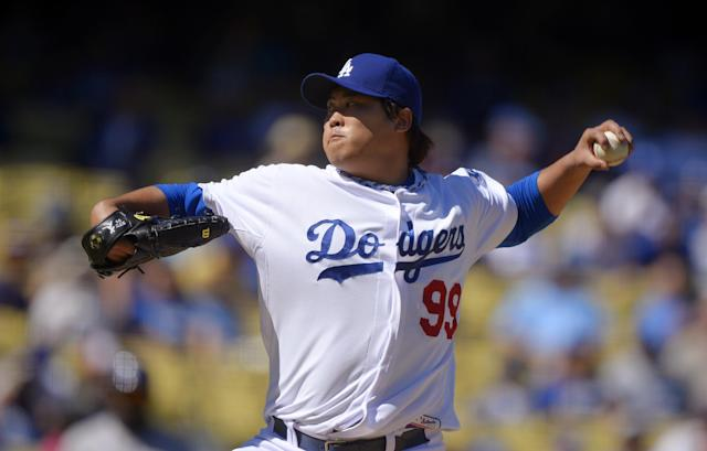 Los Angeles Dodgers starting pitcher Ryu Hyun-Jin, of South Korea, throws to the plate during the first inning of the Dodgers' baseball game against the Colorado Rockies, Sunday, Sept. 29, 2013, in Los Angeles. (AP Photo/Mark J. Terrill)