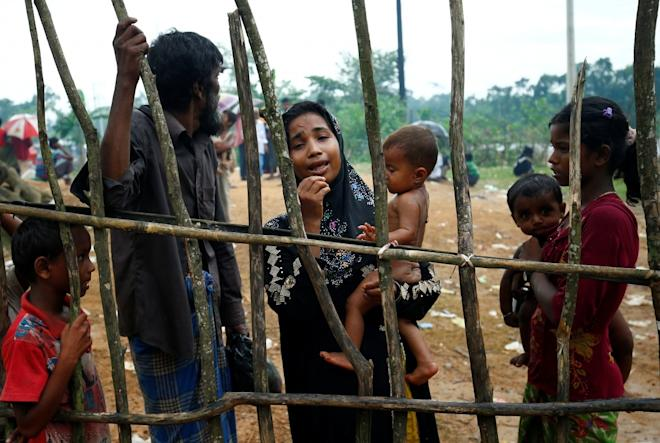 A new Rohingya refugee woman cries as they arrive near the Kutupalang makeshift Refugee Camp, in Cox's Bazar, Bangladesh.
