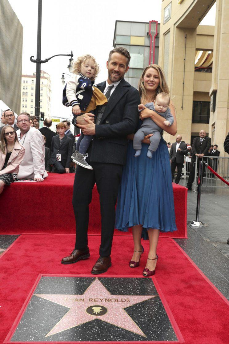 Blake Lively and Ryan Reynolds with their children. (Photo: AP)