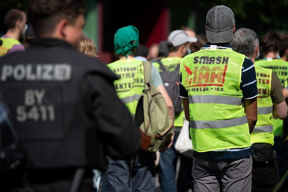 An environmental activist wearing a vest with the slogan 'Smash IAA' (REUTERS)