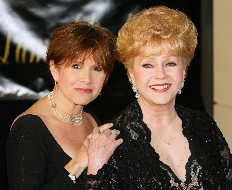 <p>Debbie Reynolds was a legend in Hollywood thanks to roles in <em>Singin' in the Rain </em>and other big studio films. Debbie had a daughter, Carrie, with singer Eddie Fisher before their acrimonious divorce where Fisher left Reynolds for her close friend, Elizabeth Taylor. Carrie Fisher was flung into stardom at an early age due but stepped into the spotlight on her own when she was cast as Princess Leia in the <em>Star Wars</em> franchise at 19. </p>