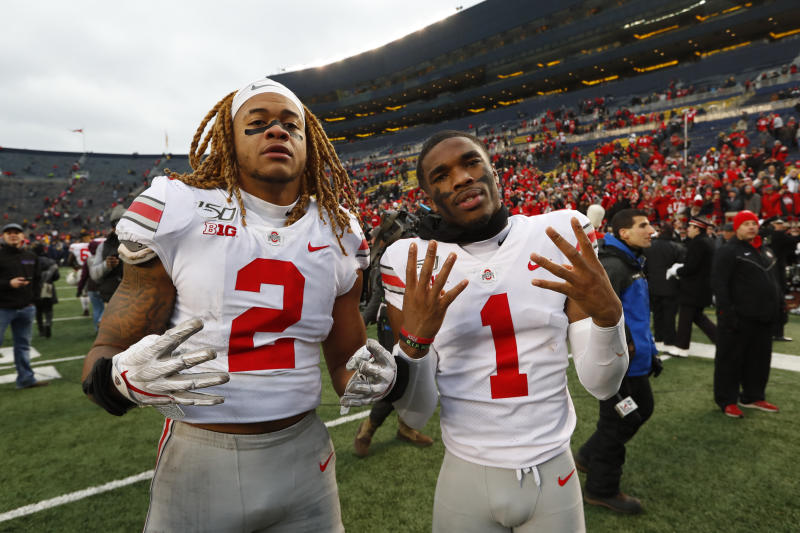 Ohio State defensive end Chase Young (2) and cornerback Jeff Okudah (1) celebrate after an NCAA college football game against Michigan in Ann Arbor, Mich., Saturday, Nov. 30, 2019. Ohio State won 56-27. (AP Photo/Paul Sancya)