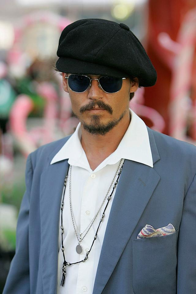 """Johnny Depp here sports a gatsby cap. This was the sort of hat popular among newspaper boys in the 1920s. Depp didn't get his start in the movie industry by being a paperboy. He got his start in the FOX TV show """"21 Jump Street."""""""